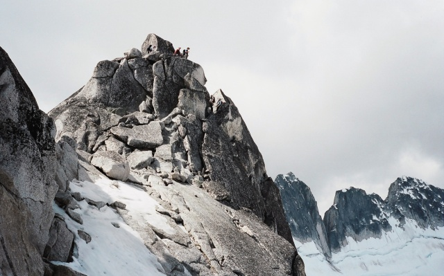 climbers taking in the view from pigeon spire peak