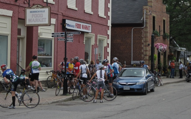 tour riders taking a break in Merrickville
