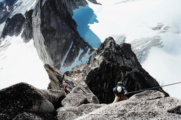 one team going up Bugaboo Spire while another climber descends