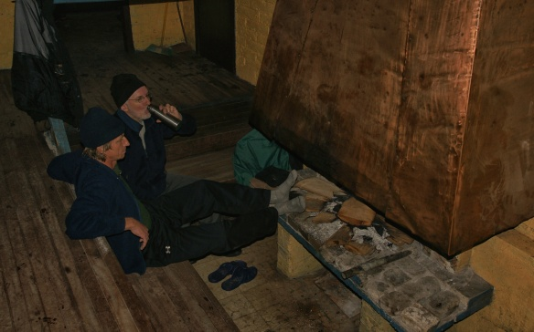sitting by the fire at the Whymper Hut