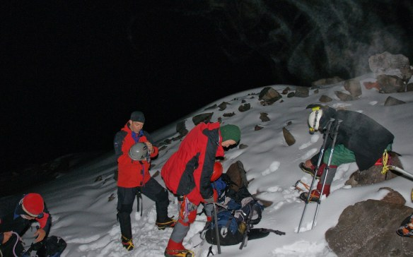 shortly after midnight- putting on the crampons