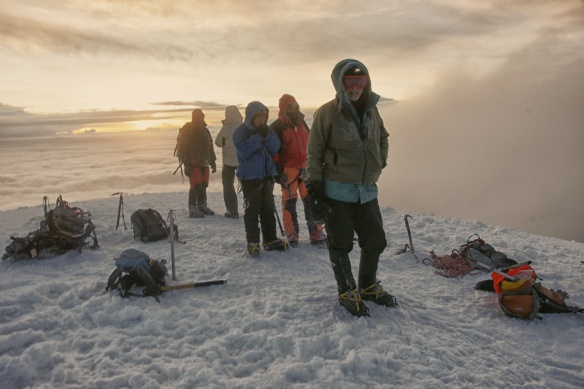climbers at dawn on Cotopaxi summit