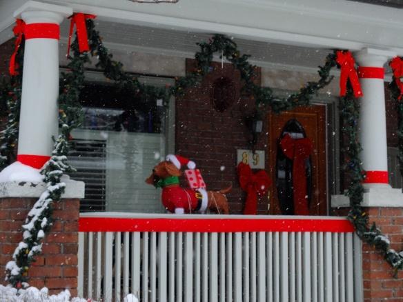 festive dachshund on the porch
