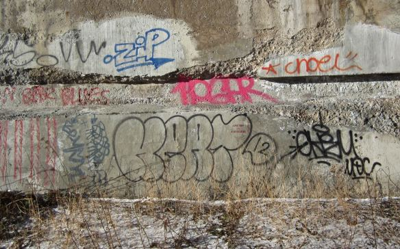 graffiti on the concrete base of the Bloor Viaduct