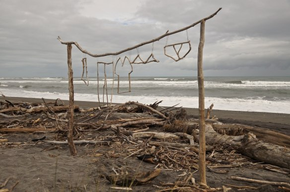 hokitika beach. driftwood art on display