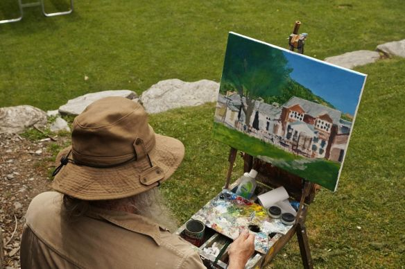 "looking over the artist's shoulder forhis ""take"" of Buckingham Green"