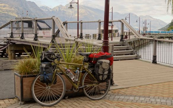 my loaded touring bike waiting at the wharf for the TSS Earnslaw trip to Walter Peak