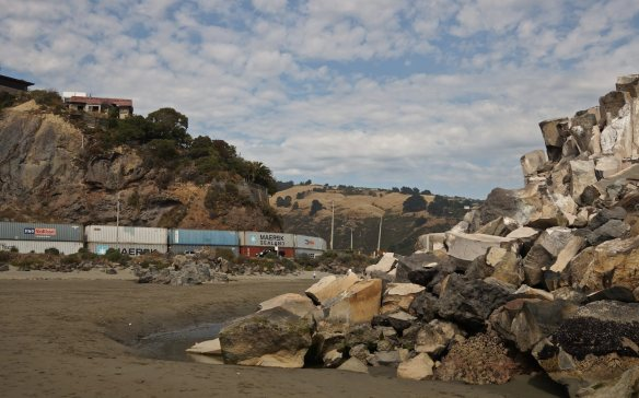 shipping containers used as rockfall barriers in Sumner