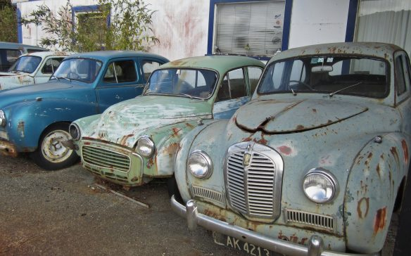 vintage car shells at a garage on the way to Greymouth from Stillwater