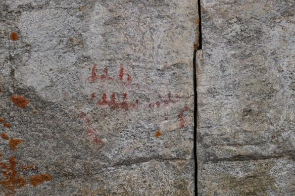Cliff Lake canoe pictographs near the human with a spine image