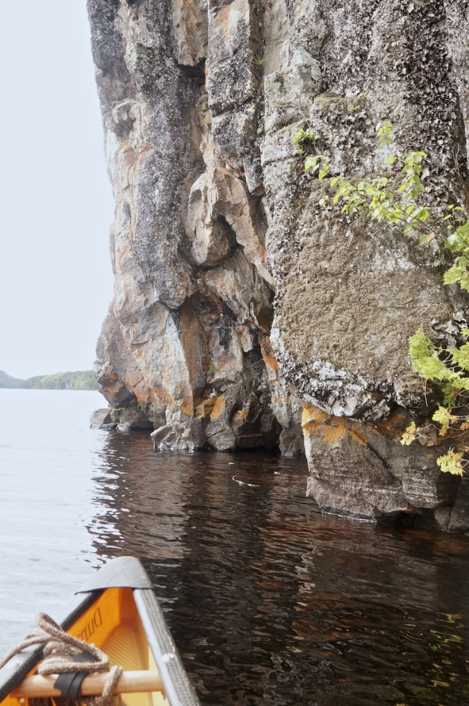 cliff lake rock face