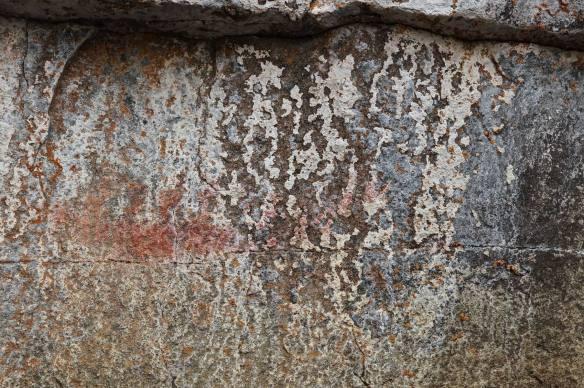 the canoe motif on basalt on Cliff Lake