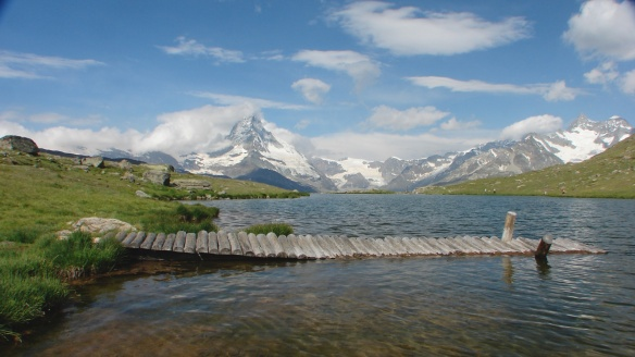 close up of dock in alpine lake with Matterhorn in the background
