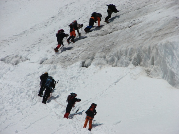 two rope teams dealing with a stretch of  steep descent