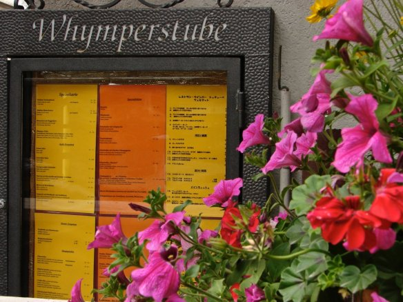 Whymperstube menu on display  - written in German and Japanese