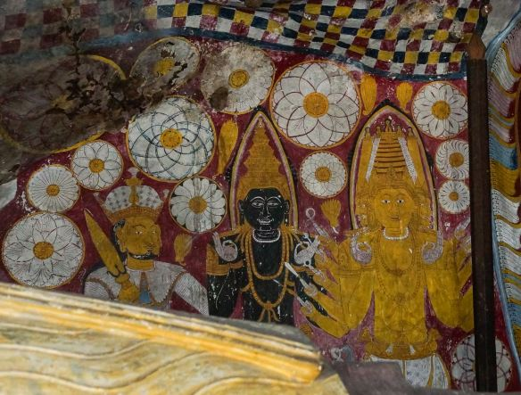 a black Vishnu flanked by Kataragama and Bandara at the Buddha's feet