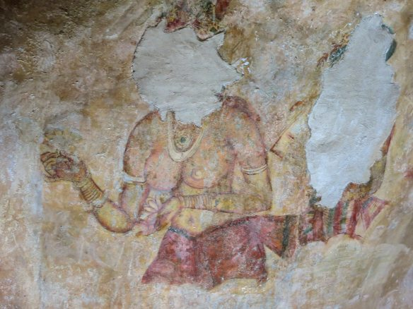 one of the  Sigiriya fresco - vandalized by an offended villager?
