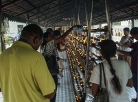 devotees lighting candles