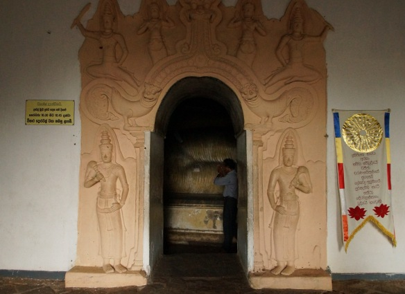 entrance to Cave 1 with its reclining Buddha figure