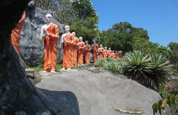 part of the line of monks approaching the Buddha