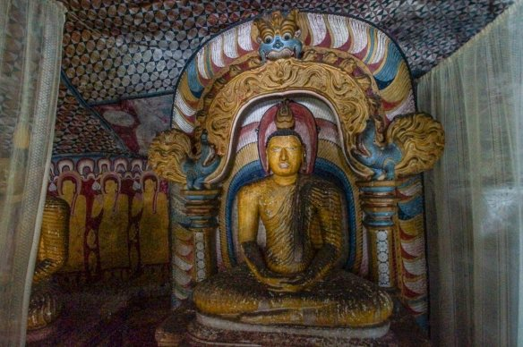 seated Buddha under makara torana arch