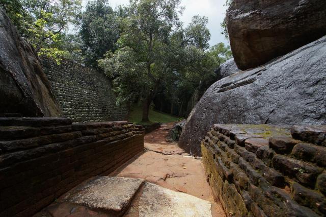 Sigiriya brick wall, boulders, and pathway