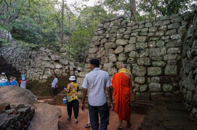Sigiriya tourists and pilgrims make their way up