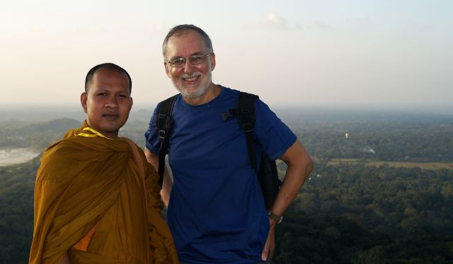 with a Cambodian monk  on the platform of the Maha Sena or Great Stupa