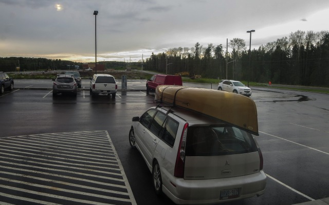 Car and canoe at the Super 8 in Red Lake