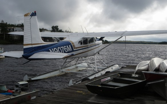 bush plane and aluminum canoes at the dock at Red Lake harbour