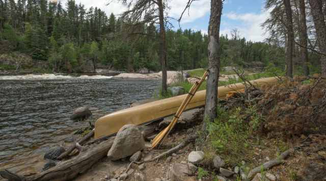 canoe at rest at Moosebone Rapids on the Bloodvein