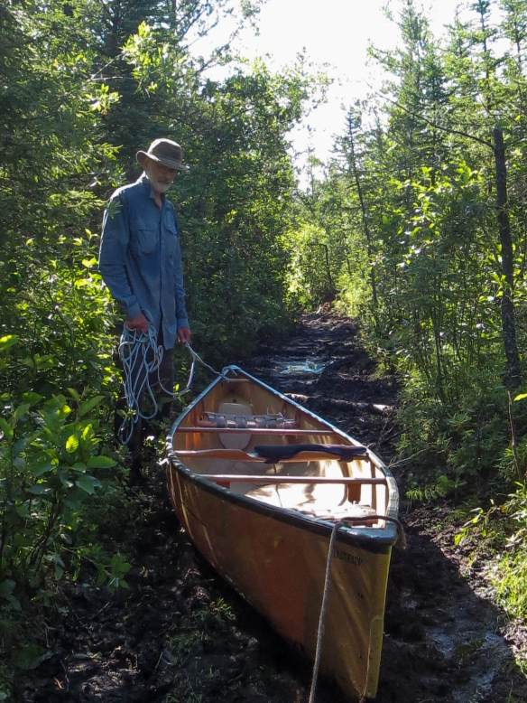hauling the canoe through the mud
