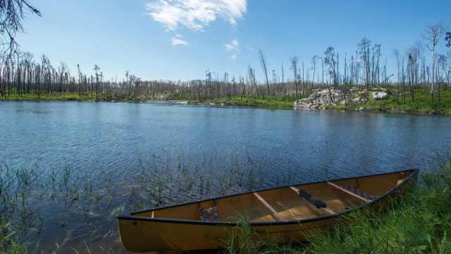 one empty canoe waiting to be portaged!