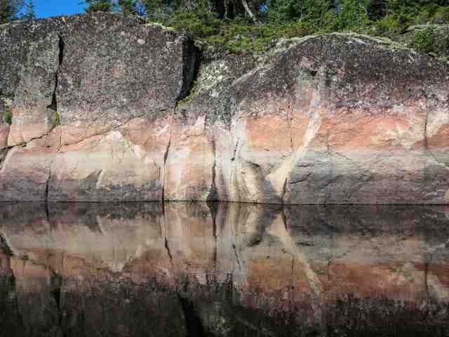 rock face and reflection on the Bloodvein
