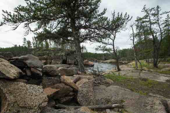 scenic campsite and fire pit at Island Chutes Rapids on the Bloodvein