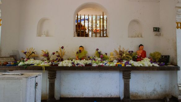 flowers left in front of Buddha images at external shrine area at Sri Maha Bodhi