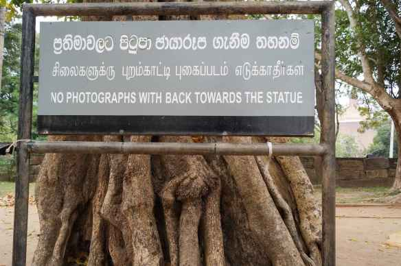 No Photograph with Back To The Buddha  sign at Anuradhapura