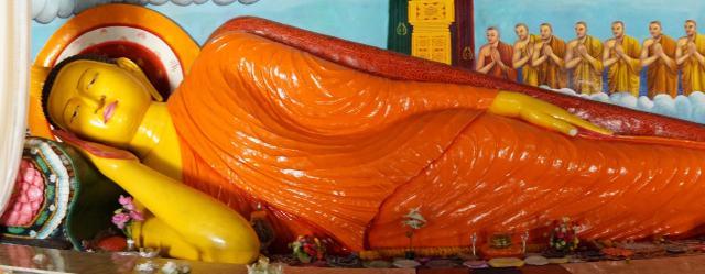 the Buddha in paranirvana position inside the shrine room