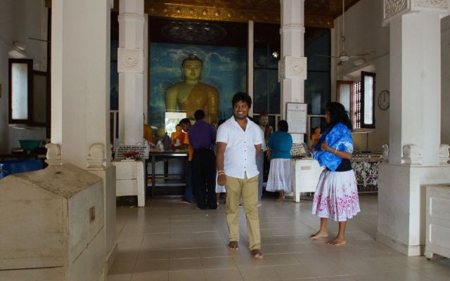 visitors inside the Sri Maha Bodhi Temple