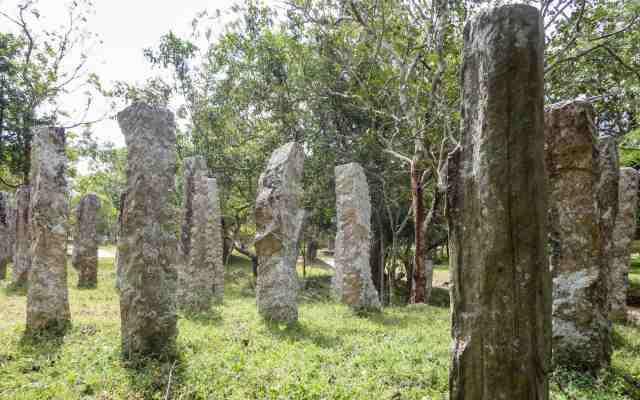 walking through the ghostly pillars in the ruins of  Abhayagiri Monastery