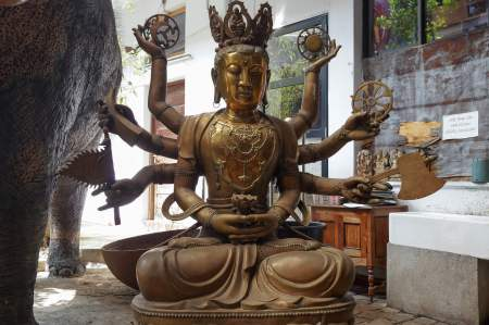 eight-armed seated Buddha figure