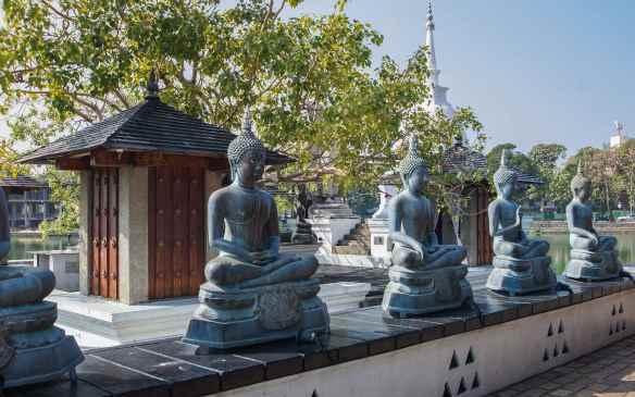 Thai Buddhas line a Seema Malaka wall
