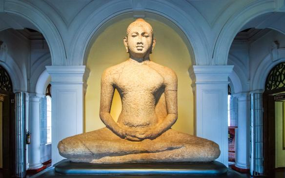 the seated Buddha in meditation pose at the entrace of Sri Lanka's National Museum in Colombo