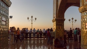 47. western tourists making sunset puja at Mandalay Hill pagoda