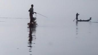 70. fishermen in Inle Lake morning mist