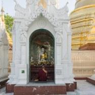9. monk at worship at Shwedagon