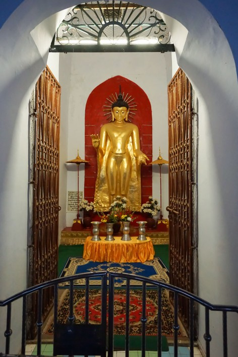 one of the four standing metal Buddhas at Shwe-zigon