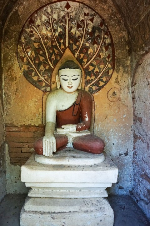 seated Buddha with painted Bodhi Tree behind him