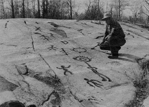 Peterborough Petroglyphs with man examining