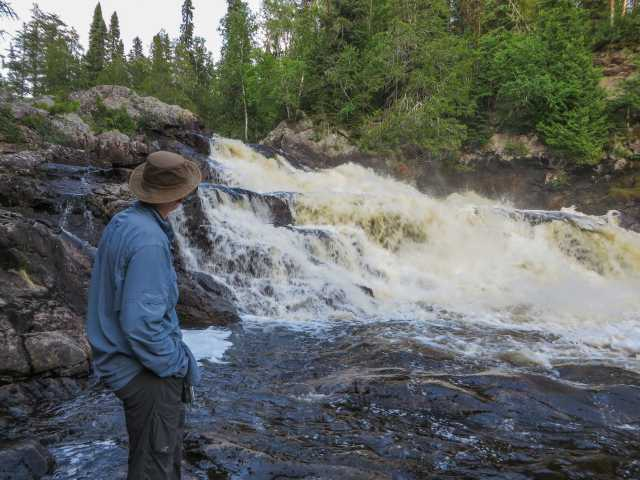 checking out the drop at Rainbow Falls